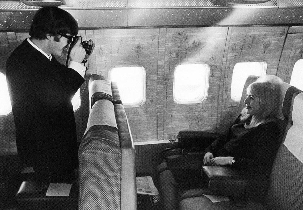 John and Cynthia Lennon aboard and aeroplane, 1964.