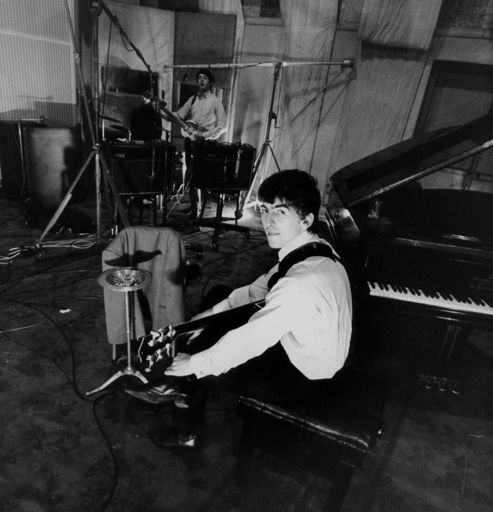 George Harrison and Paul McCartney at Abbey Road, 1964.