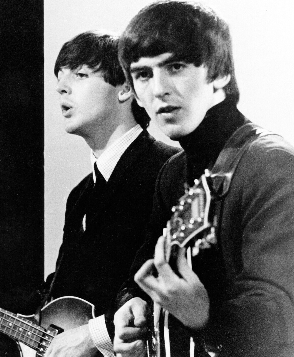 George Harrison and Paul McCartney, circa 1964.