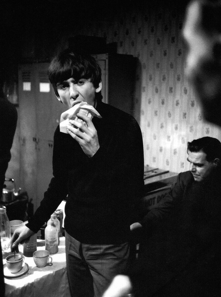 George Harrison enjoying tea and sandwiches, 1964.
