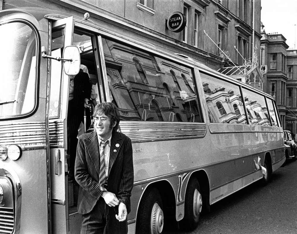 John Lennon getting off the Magical Mystery Tour bus in Newquay, 1967.