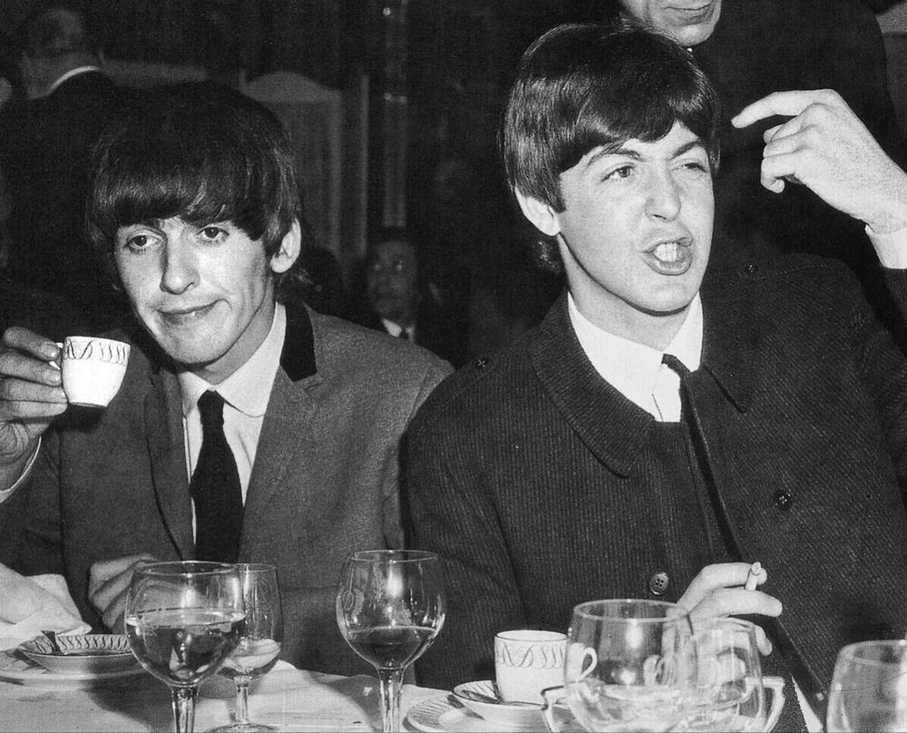 George Harrison and Paul McCartney, 1964.