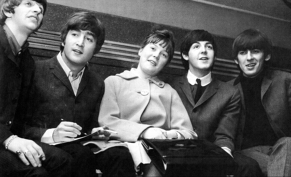 John Lennon and Paul McCartney with one lucky fan, 1964.