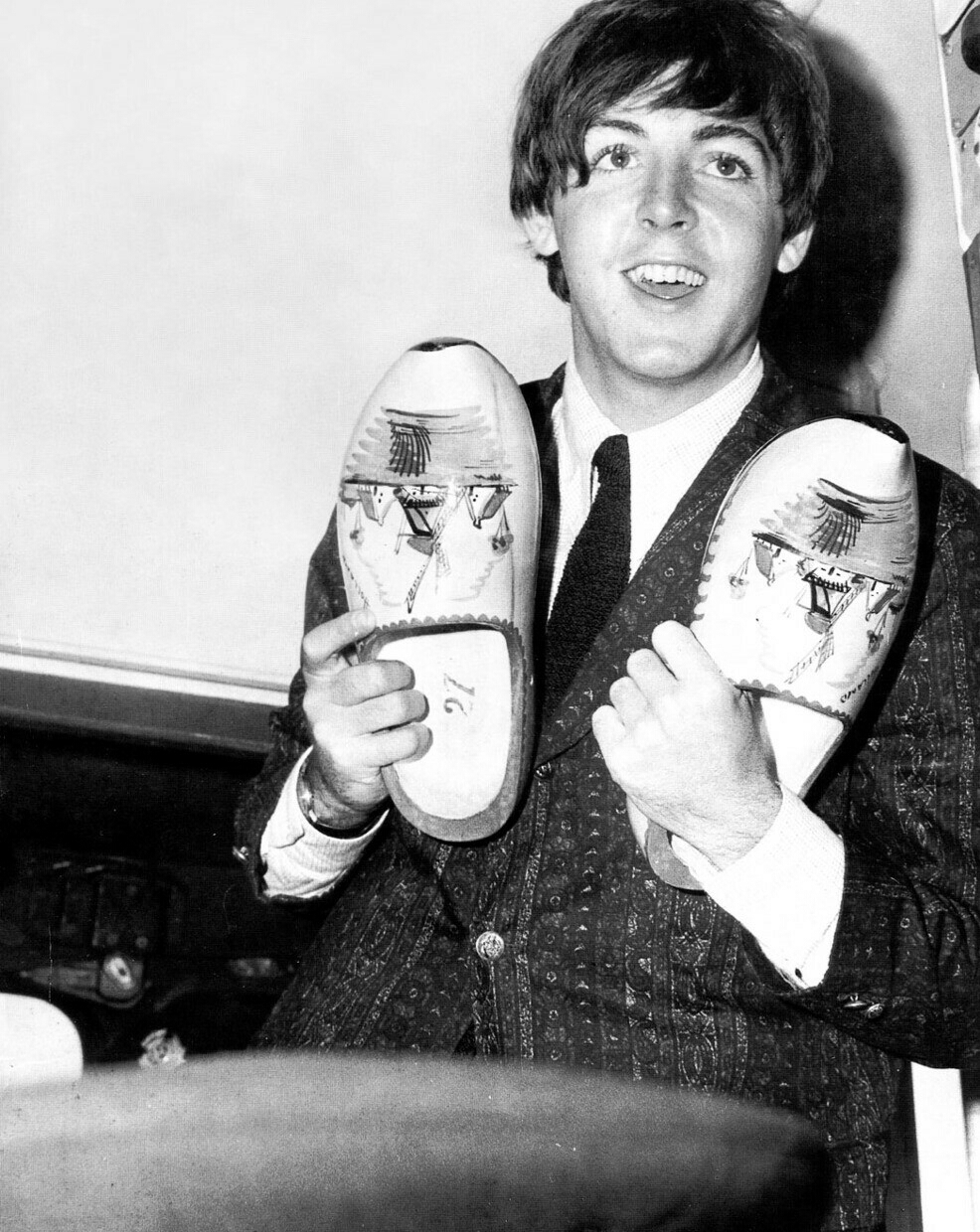 Paul McCartney with a pair of clogs, circa 1965.