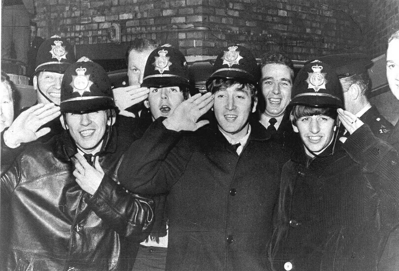 The Beatles pose with Birmingham police, 1963.