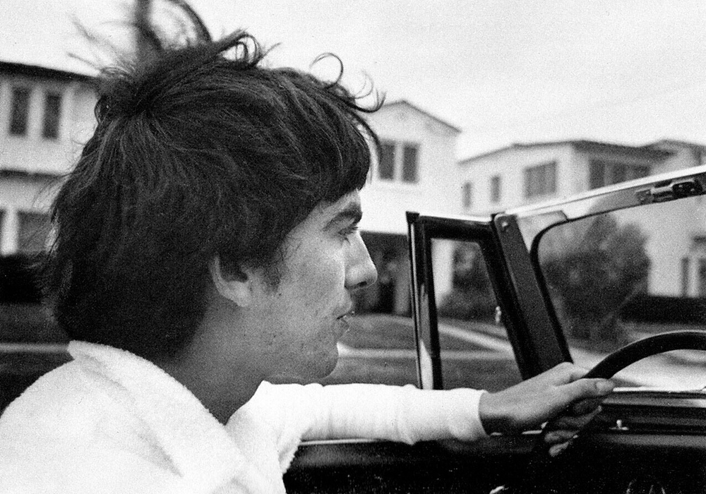 George Harrison driving a convertible, 1965.
