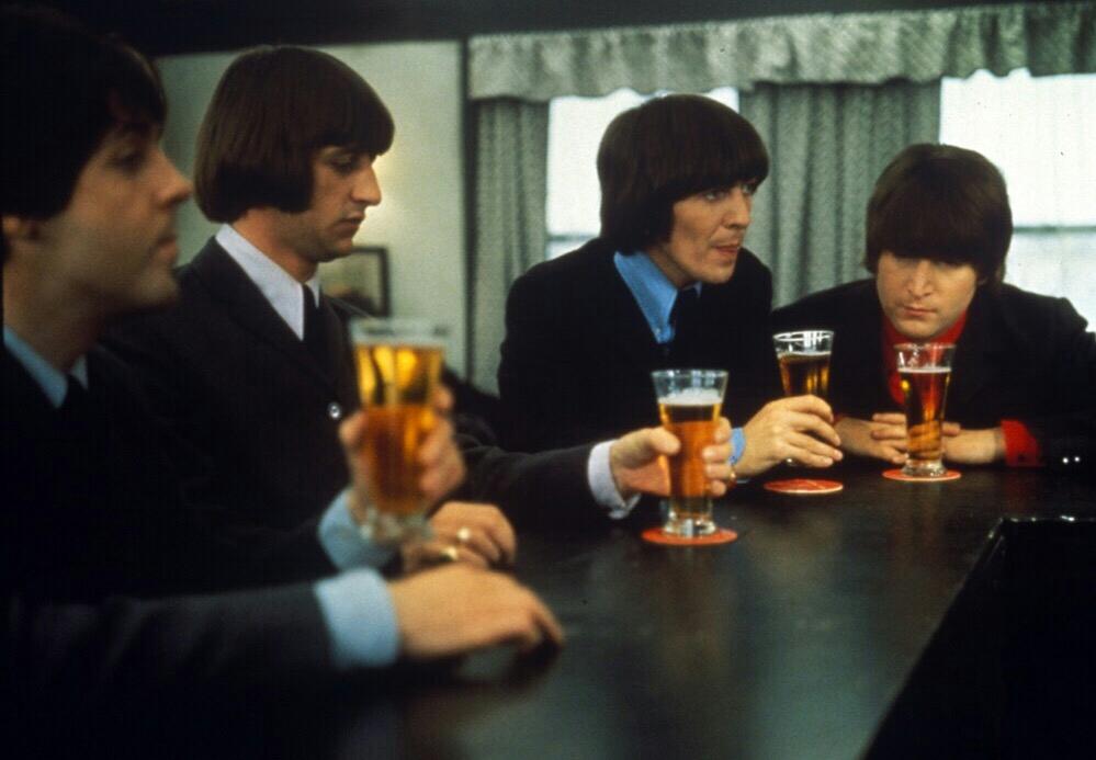 The Beatles drinking beer in Austria, 1965.