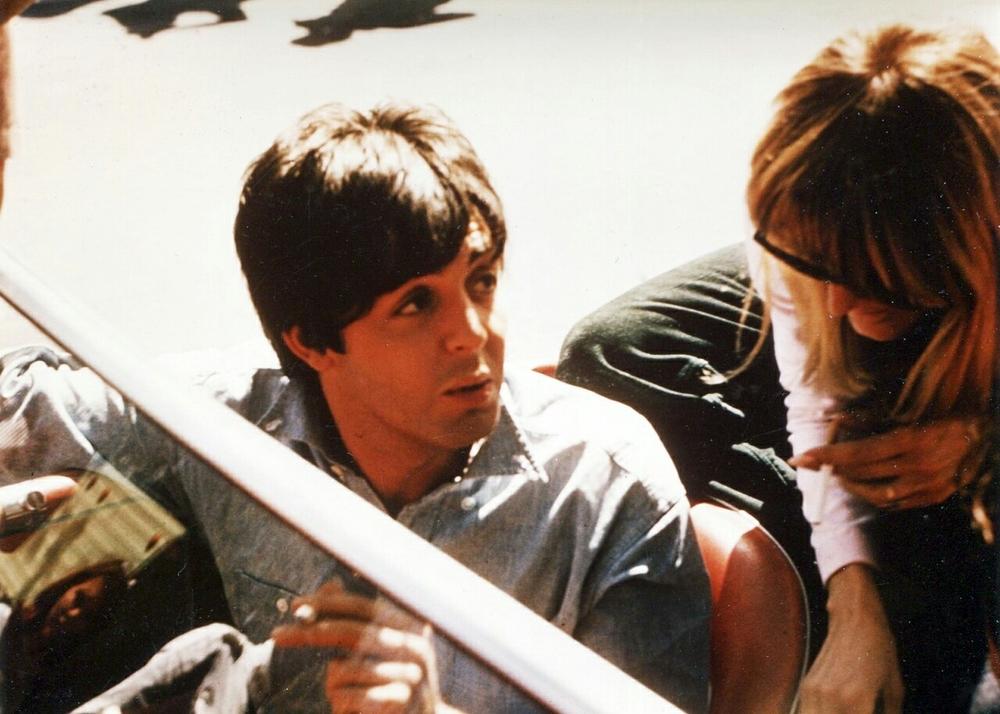 Paul McCartney signing an autograph, 1965.