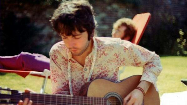 Paul McCartney playing guitar at John Lennon's home in Weybridge, circa 1967.