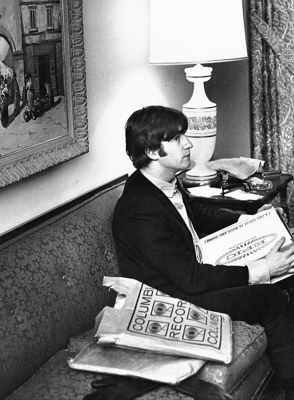 John Lennon with a bag full of records, 1964.