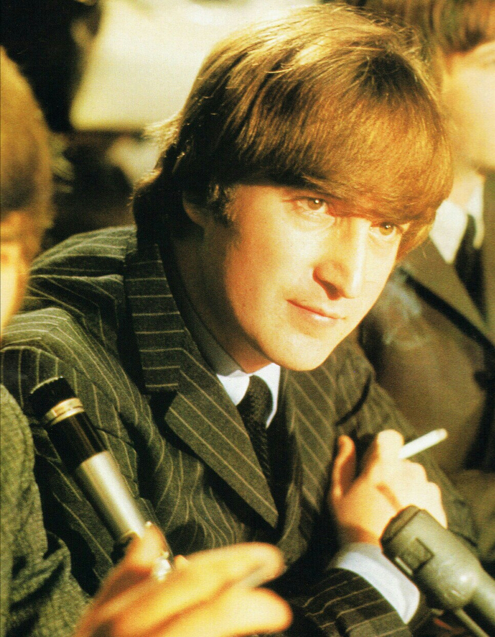 John Lennon at a Beatles' press conference, circa 1965.