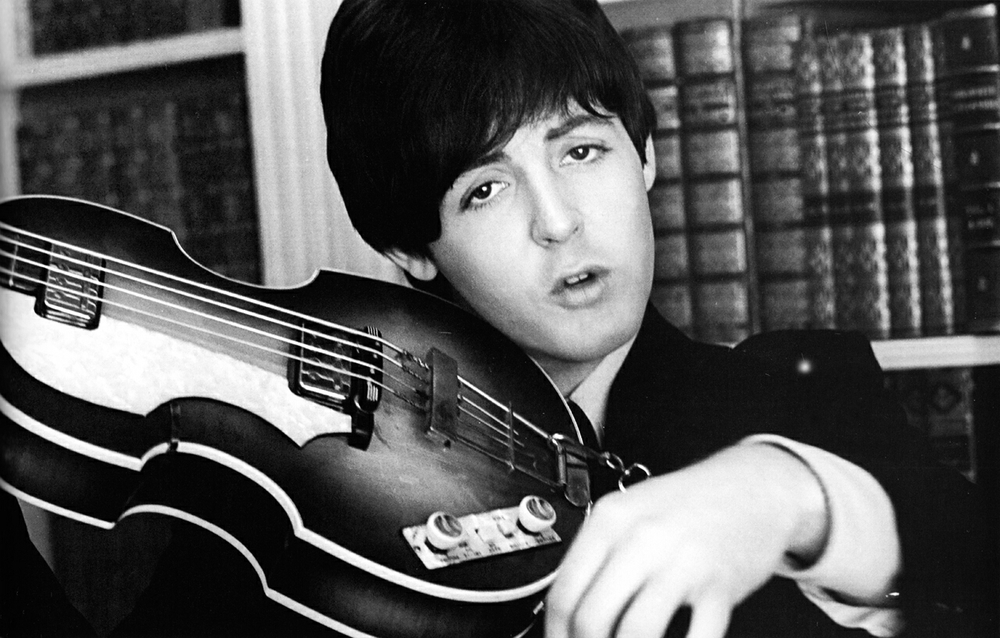 Paul McCartney with his Hofner bass on the set of Help! 1965.