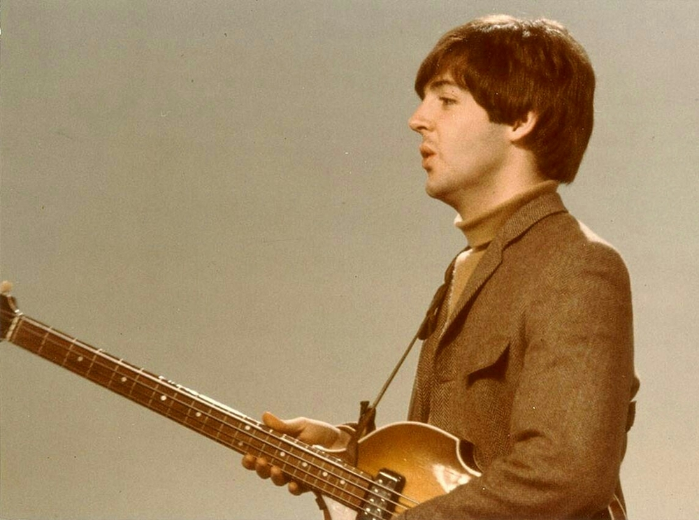 Paul McCartney with his Hofner bass, 1965.