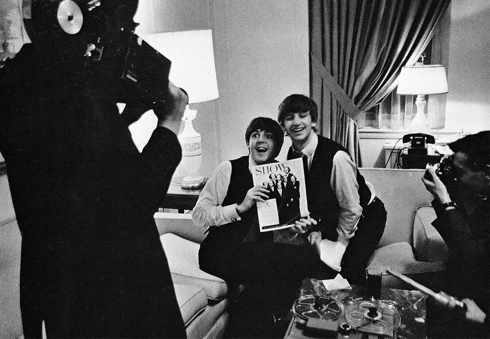 Paul McCartney and Ringo Starr photographed in a hotel room in America, 1964.