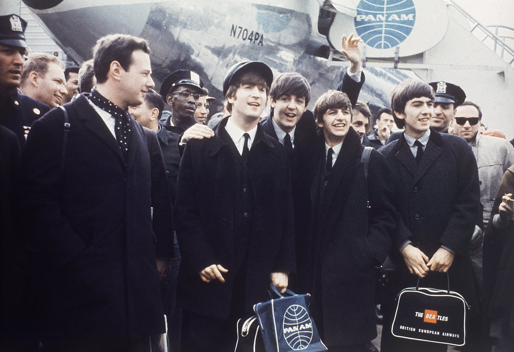 The Beatles begin their American invasion with Brian Epstein, 1964.