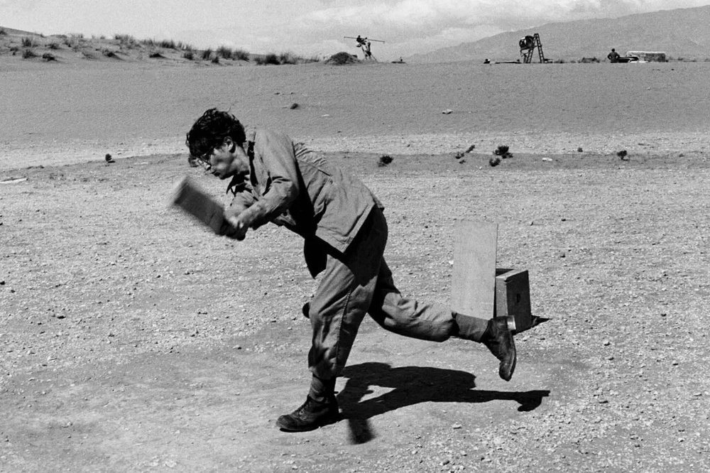 John Lennon playing cricket on the set of How I Won the War, 1966.
