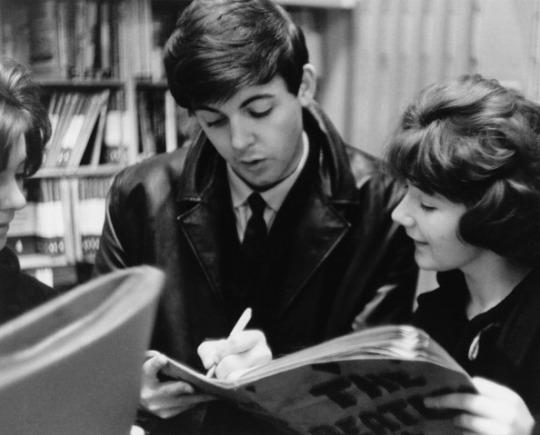 Paul McCartney signing autographs, circa 1963.