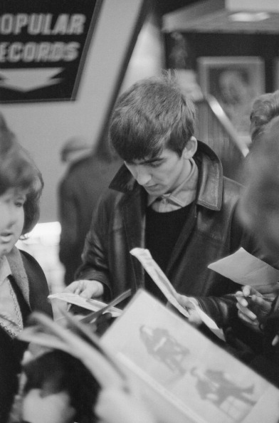George Harrison signing autographs, circa 1963.