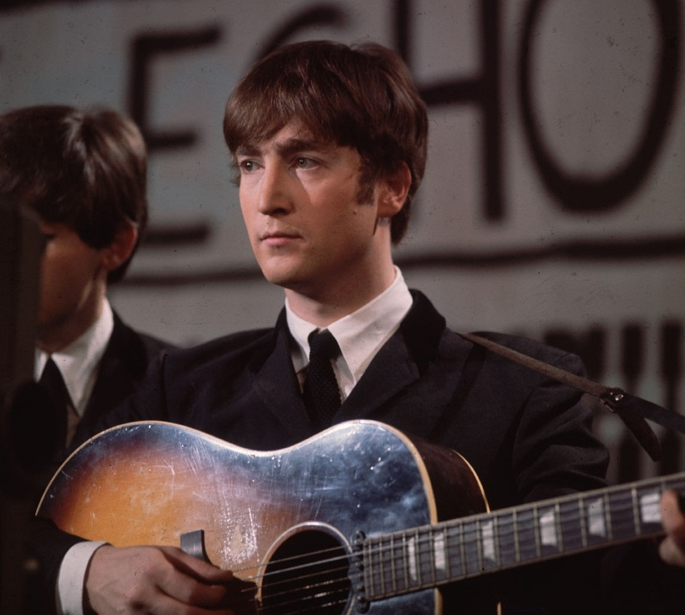 John Lennon photographed with the Beatles, 1963.