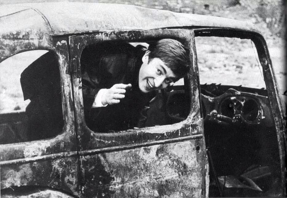 John Lennon at an early Beatles' photo shoot, circa 1963.