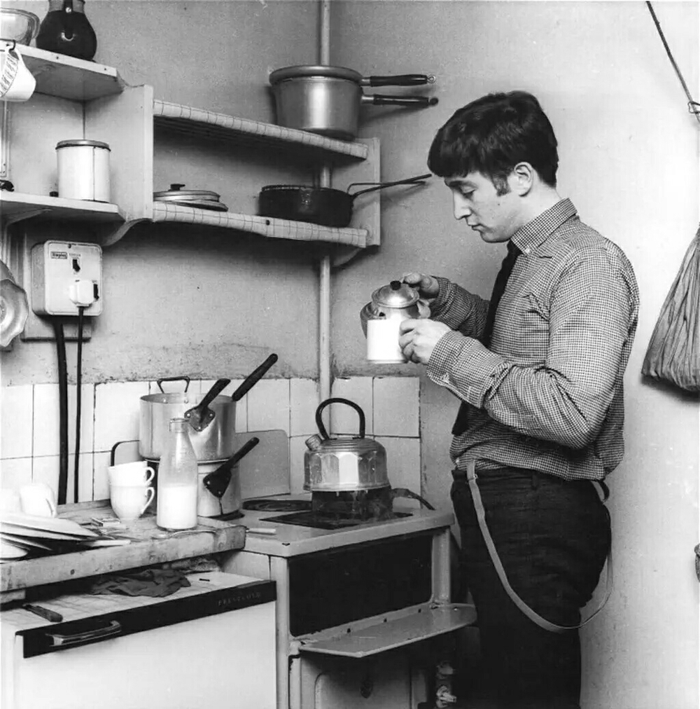 Jo hn Lennon making a cup of tea, 1963.