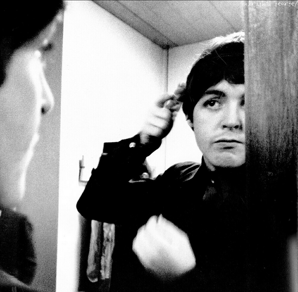 Paul McCartney fixing his hair, 1964.