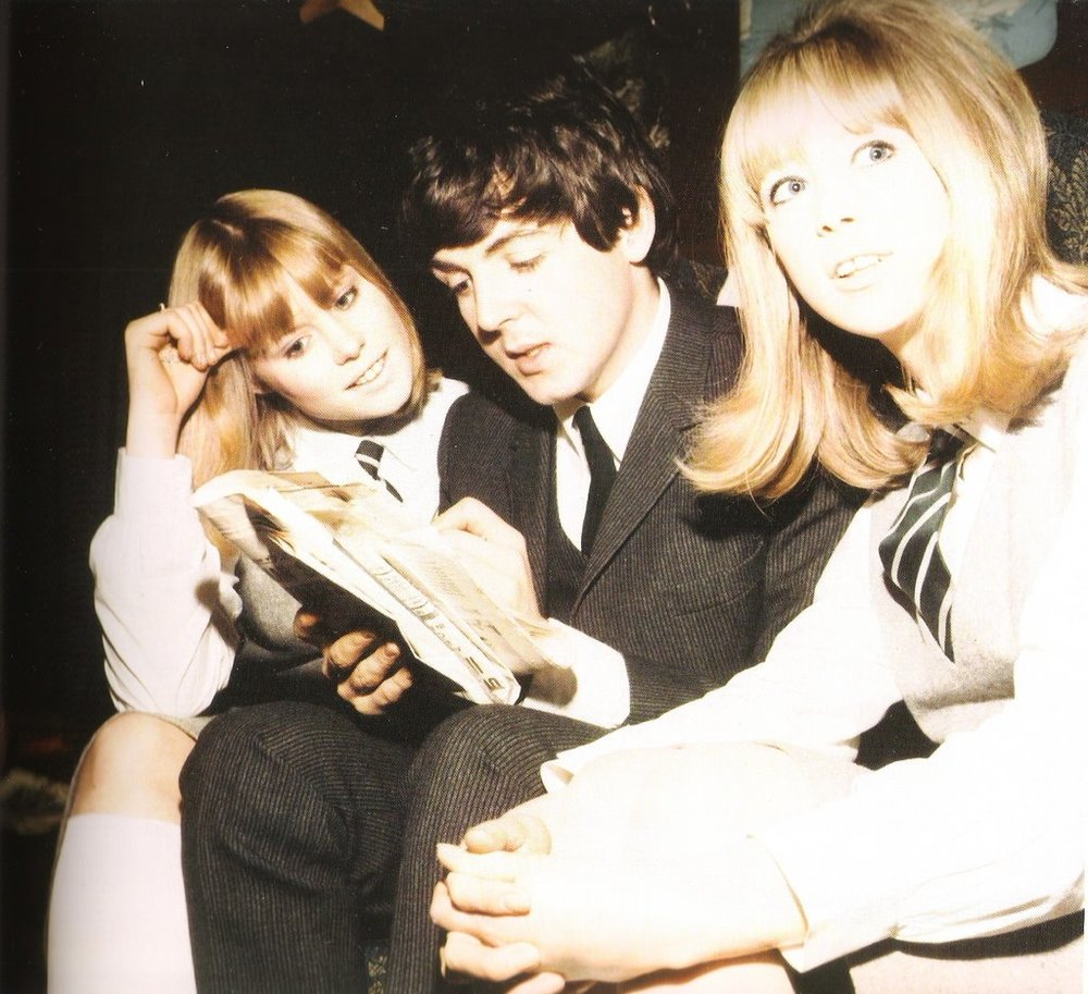 Paul McCartney on the set of A Hard Day's Night with Pattie Boyd, 1964.