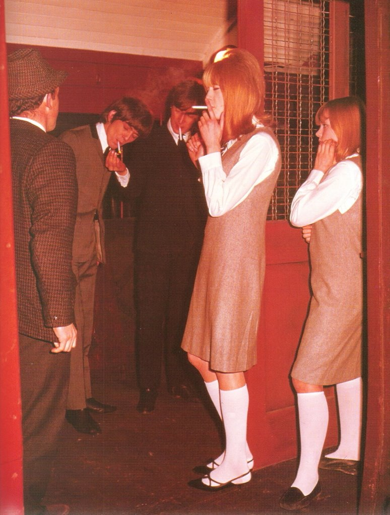 The Beatles on the set of A Hard Day's Night with Pattie Boyd, 1964.
