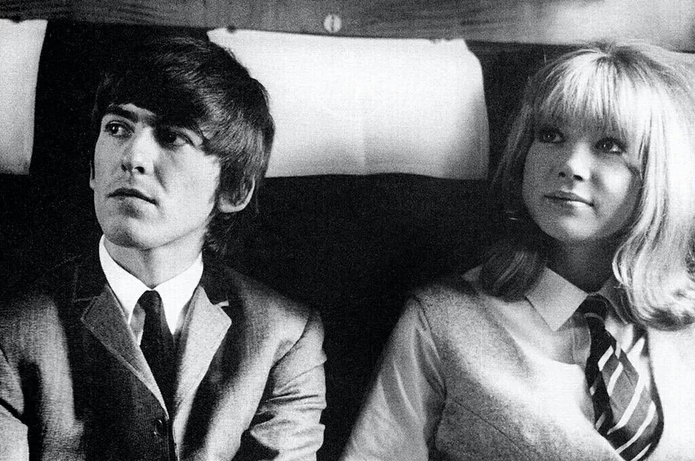 George Harrison on the set of A Hard Day's Night with Pattie Boyd, 1964.