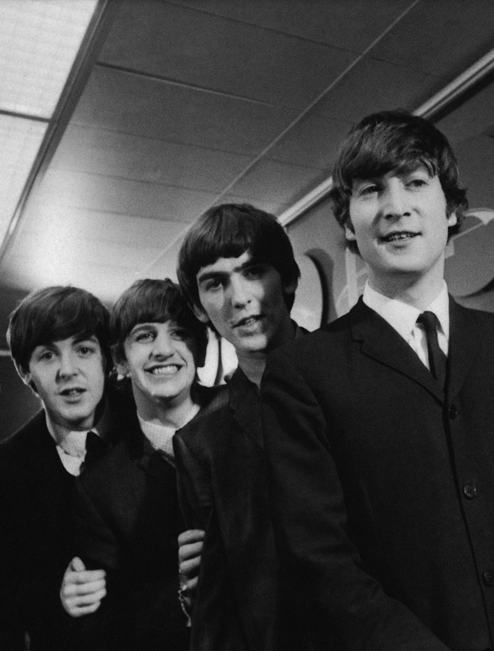 The Beatles at a press conference in America, 1964.
