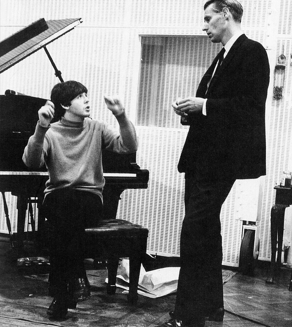 Paul McCartney and George Martin at Abbey Road, 1964.