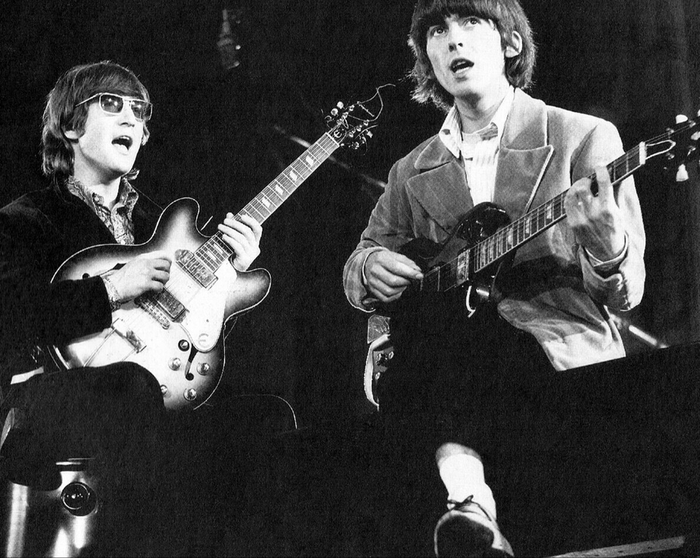 John Lennon and George Harrison, 1966.