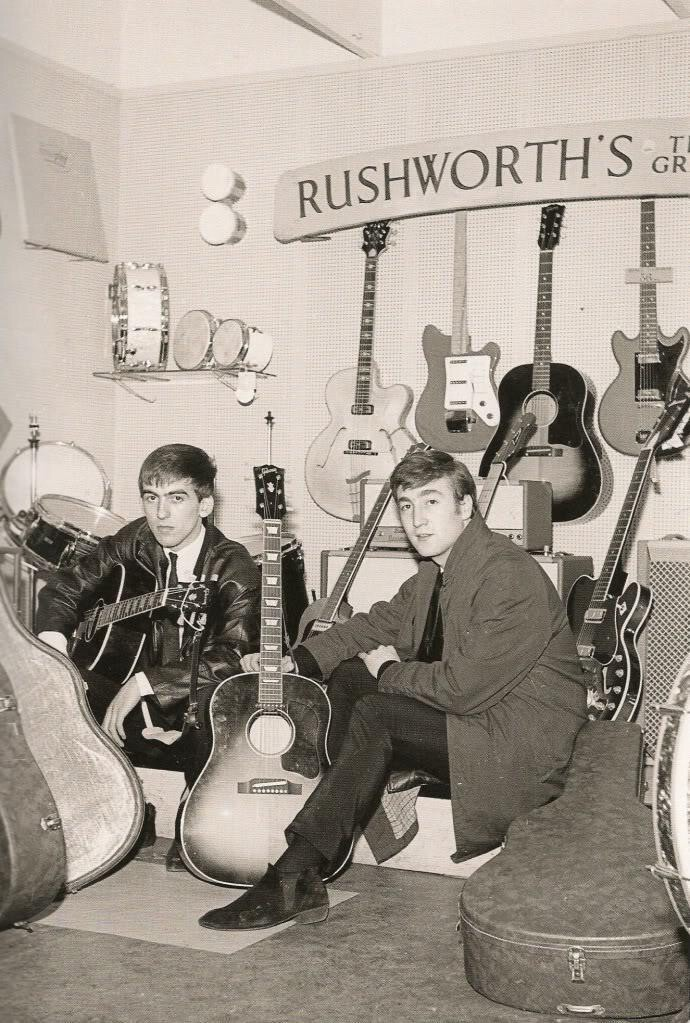 George Harrison and John Lennon at Rushworth's guitar store, circa 1962.
