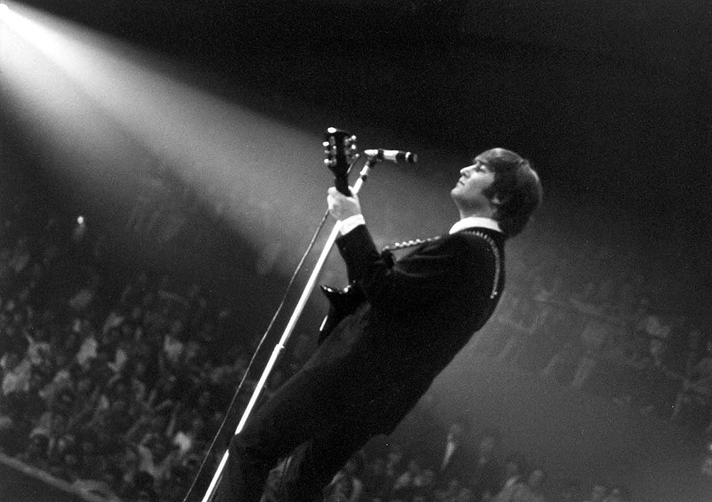 John Lennon on stage in the US, 1964.