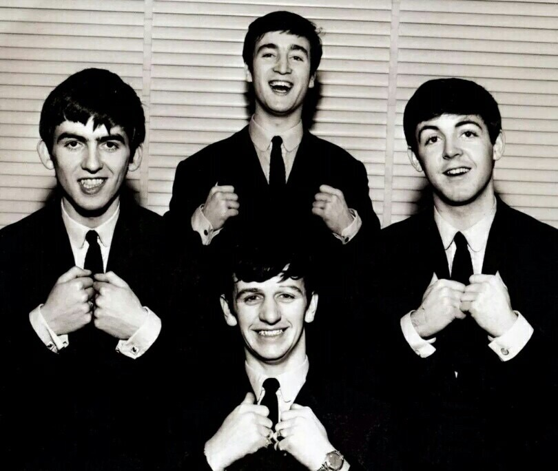 The Beatles at a photo shoot, circa 1962.