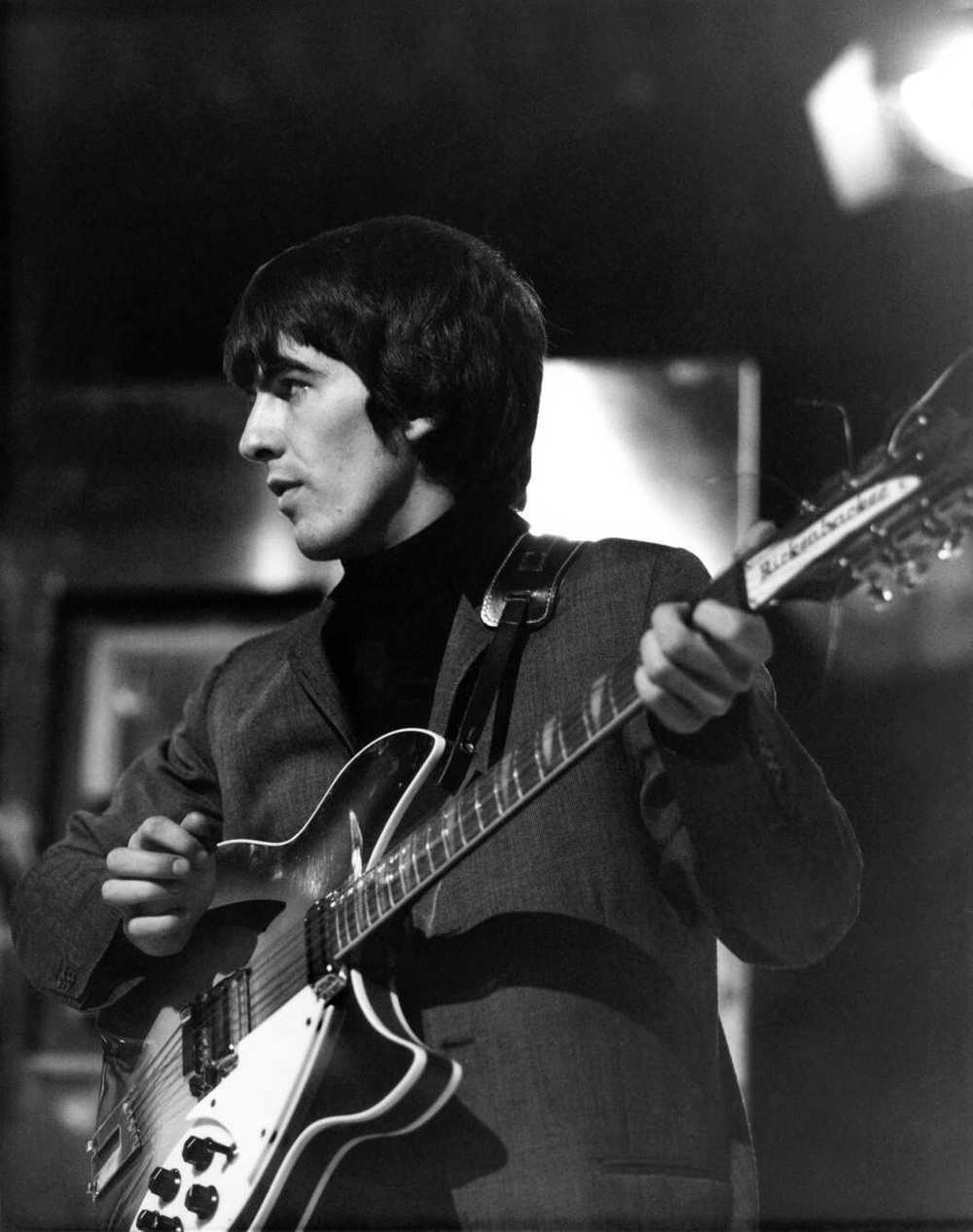 George Harrison on stage, circa 1964