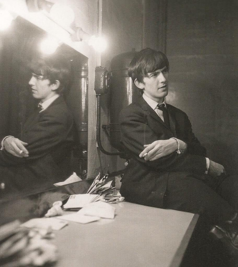 George Harrison in a dressing room, 1964.