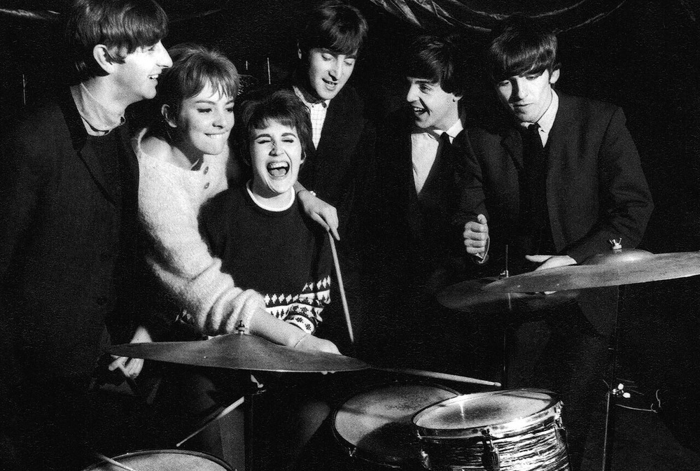 The Beatles with a couple of lucky fans, circa 1964.