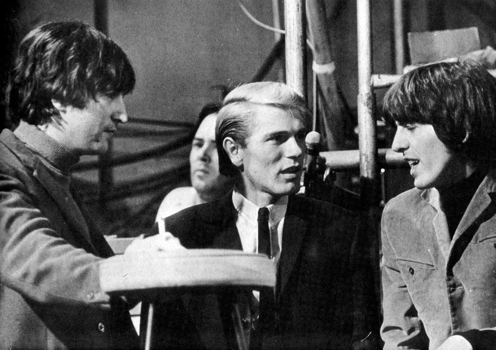The Beatles with British singer Adam Faith, circa 1965.