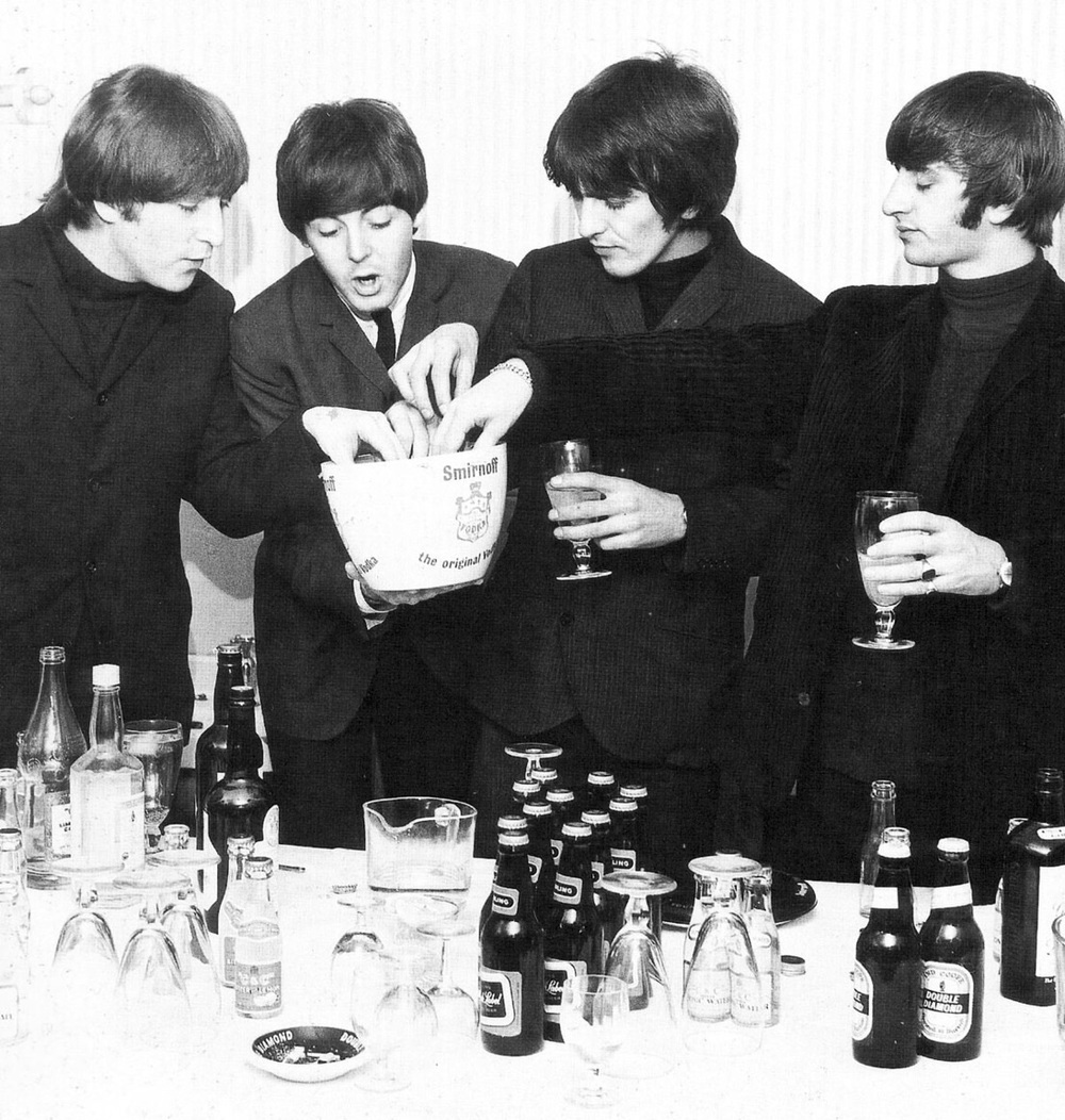 The Beatles fixing drinks, 1964.