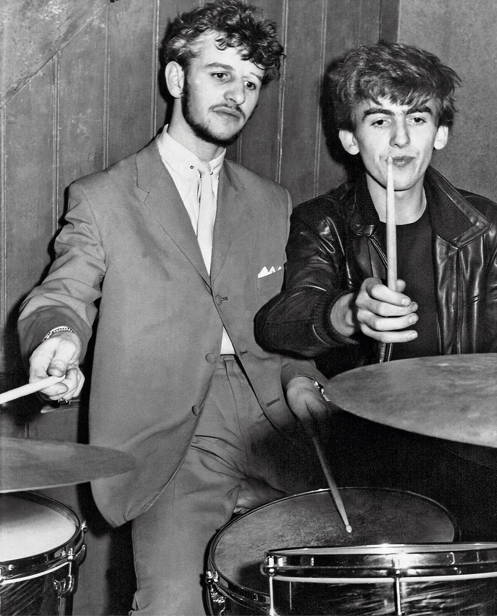 Ringo Starr and George Harrison playing drums, circa 1962.
