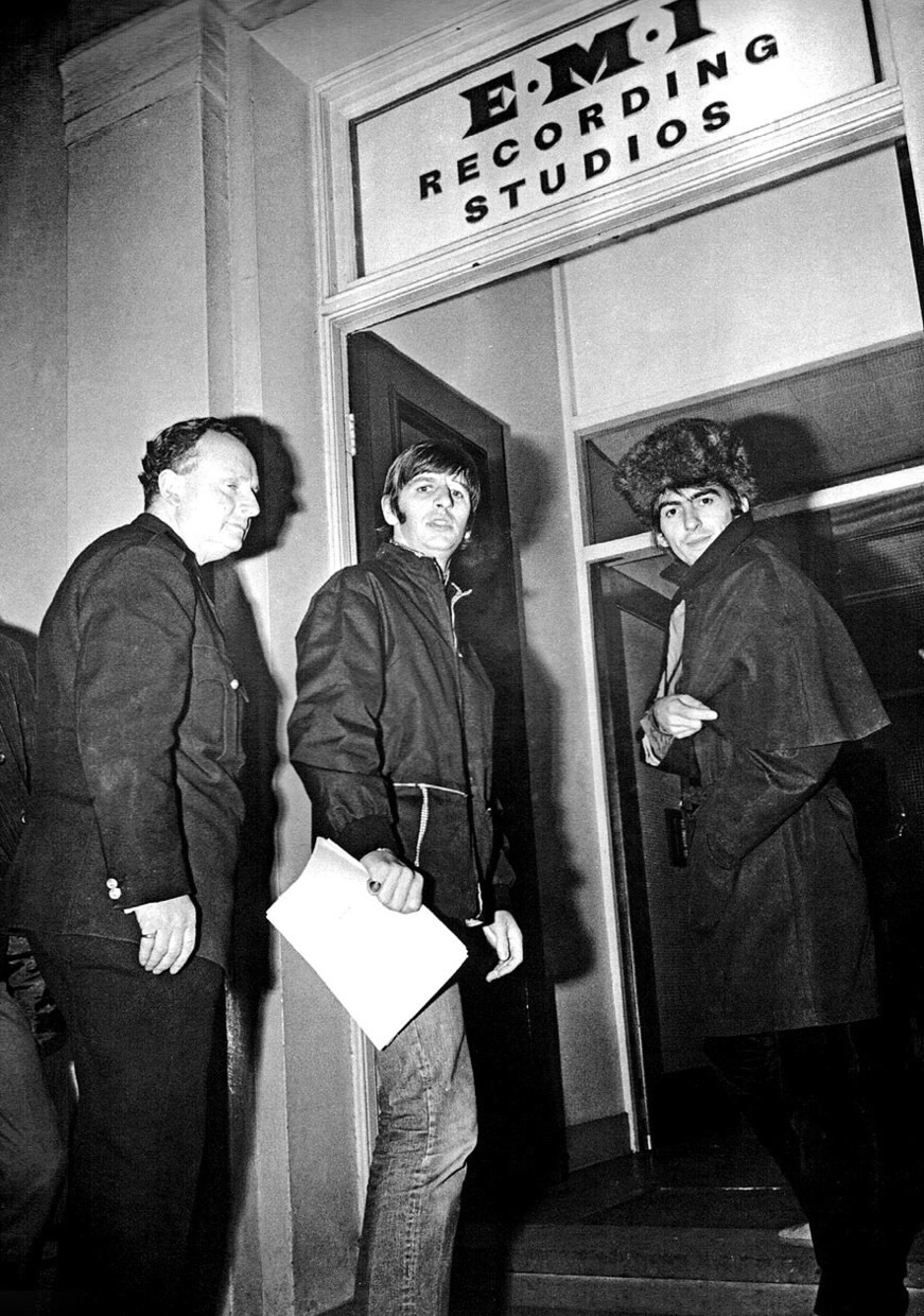 Ringo Starr and George Harrison outside Abbey Road Studios, circa 1964.