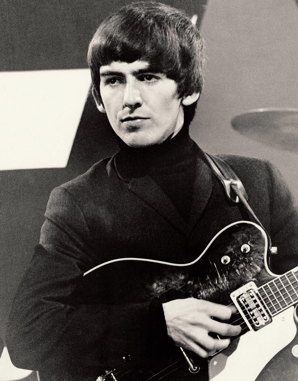 George Harrison on stage, 1964.
