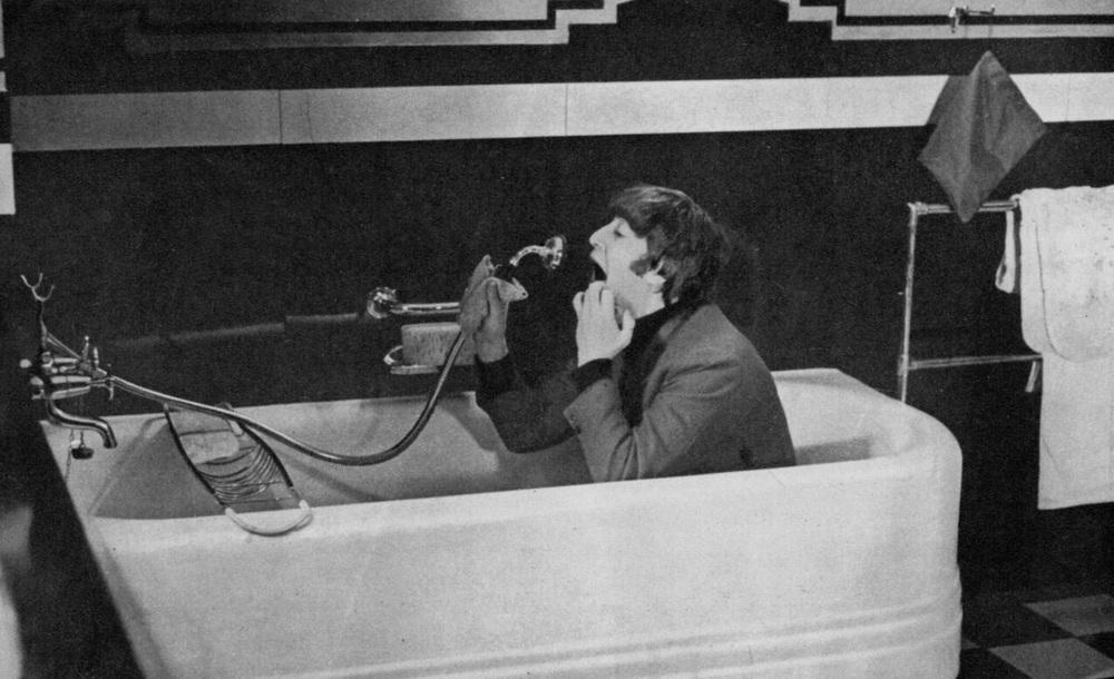 John Lennon filming a scene for A Hard Day's Night, 1964.