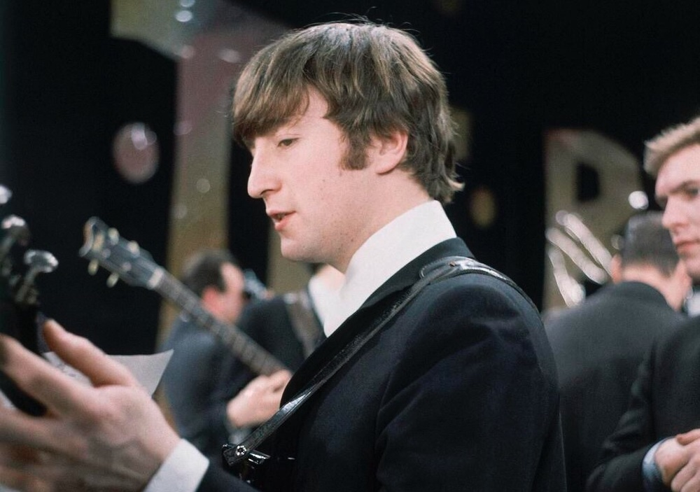 John Lennon rehearsing for the Ed Sullivan Show, 1964.