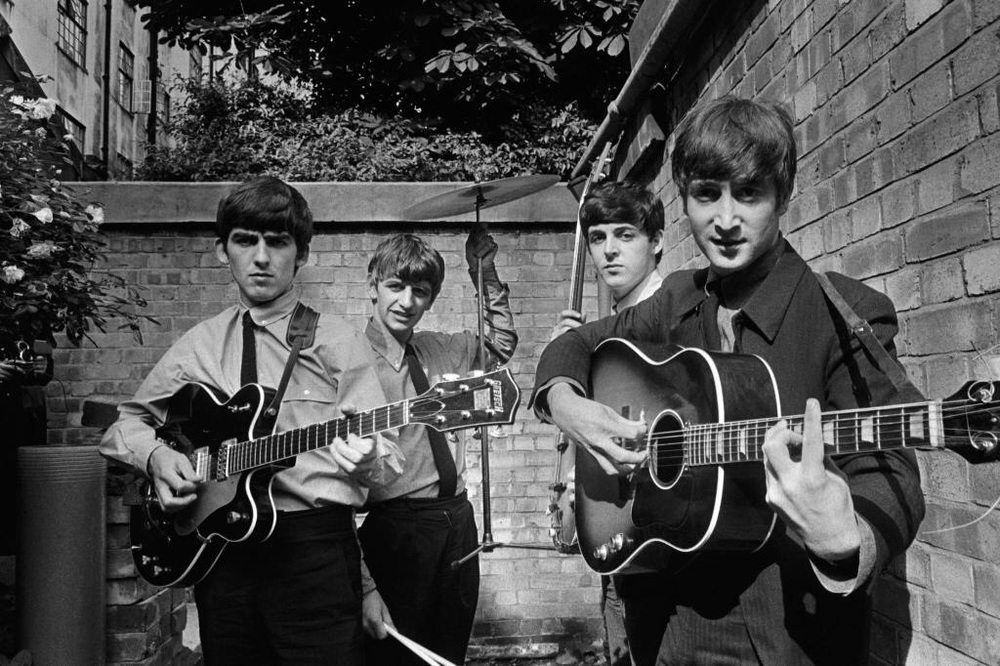 The Beatles at the back of Abbey Road Studios, 1963.