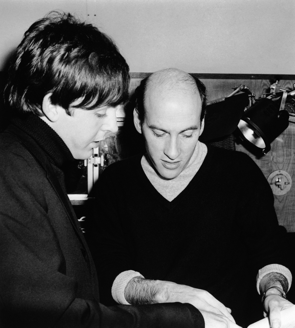 Paul McCartney on the set of A Hard Day's Night with director Dick Lester, 1964.