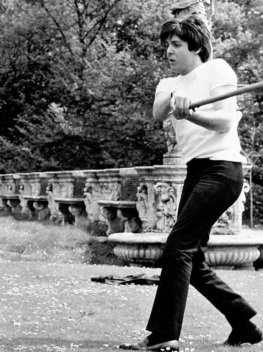 Paul McCartney playing baseball, circa 1965.
