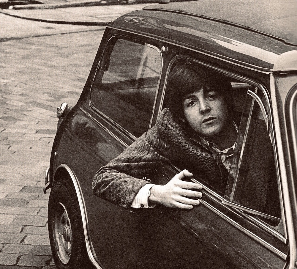 Paul McCartney in a Mini Cooper, 1965.