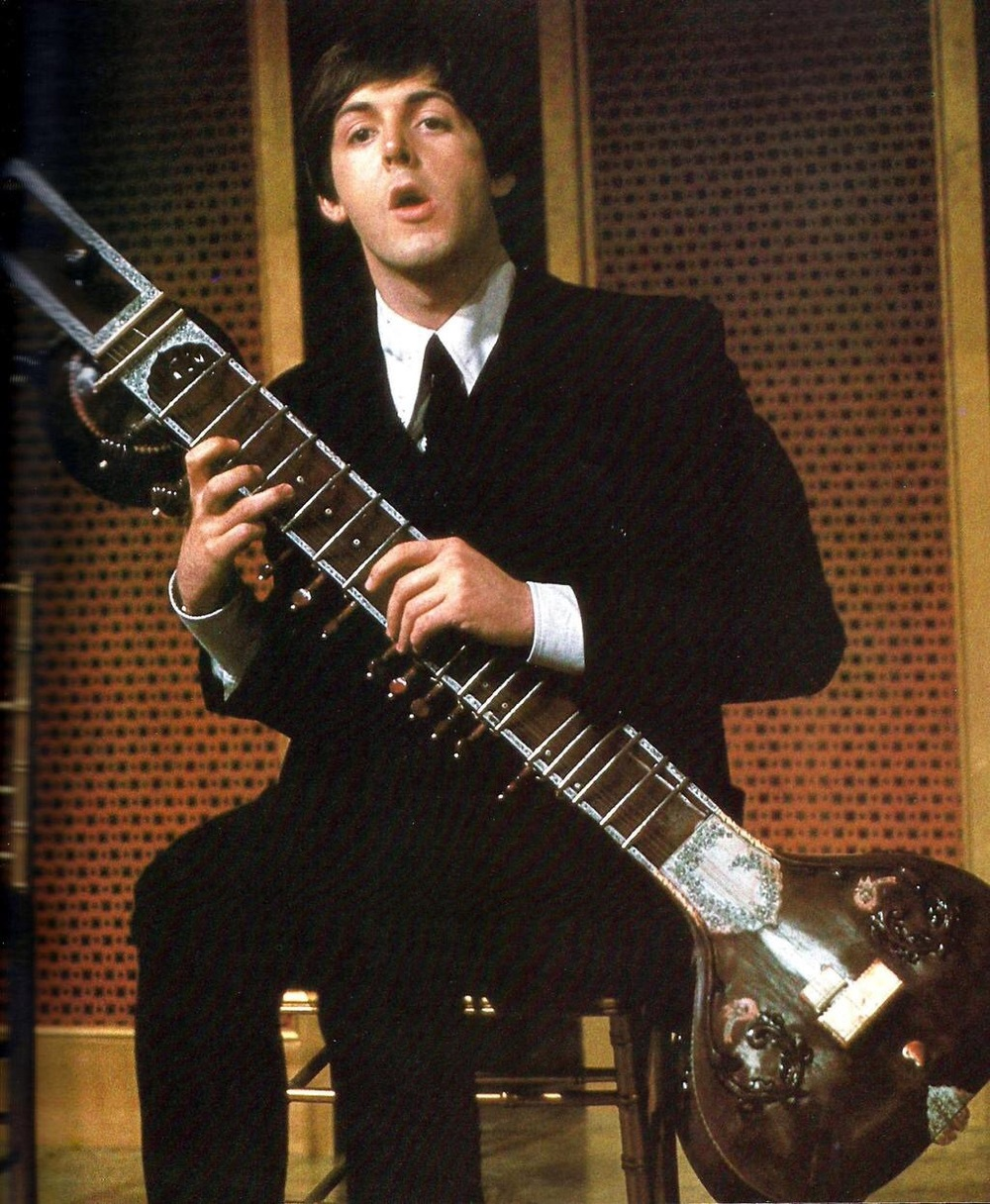 Paul McCartney with a sitar, circa 1965.